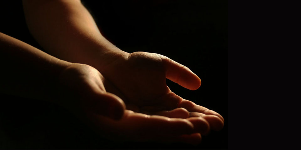 Hands out to receive the gifts of the Holy Spirit