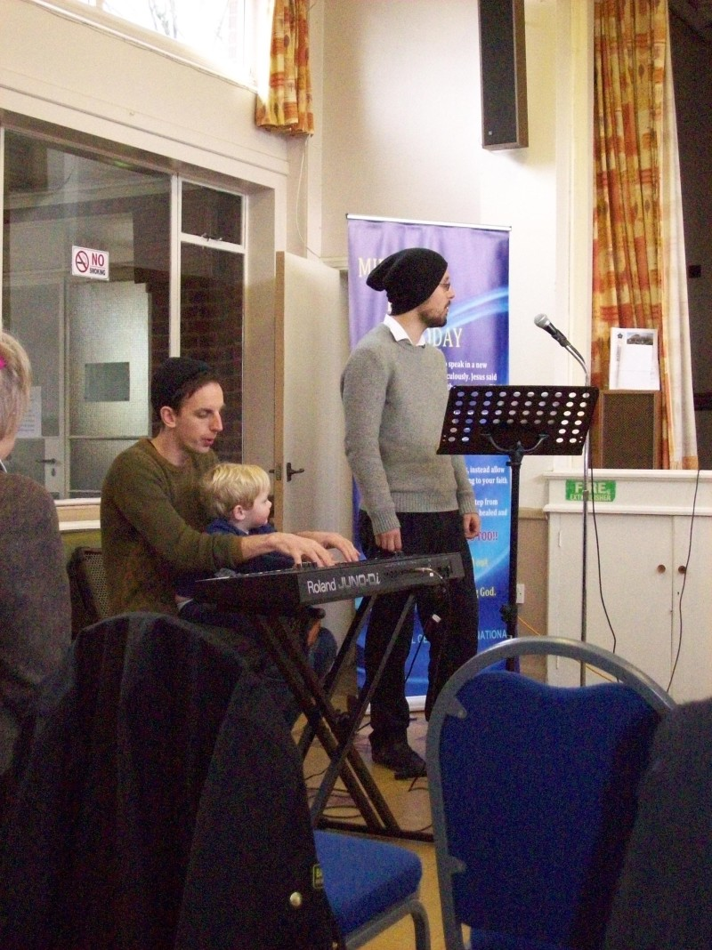Pastor Robby and his son Fin playing the keyboard