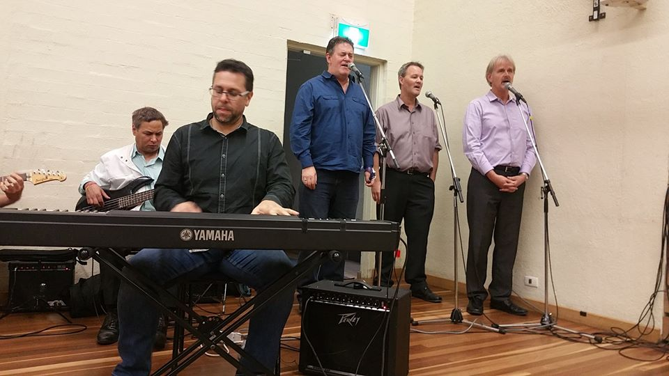 Band and backing-singers during the meeting.