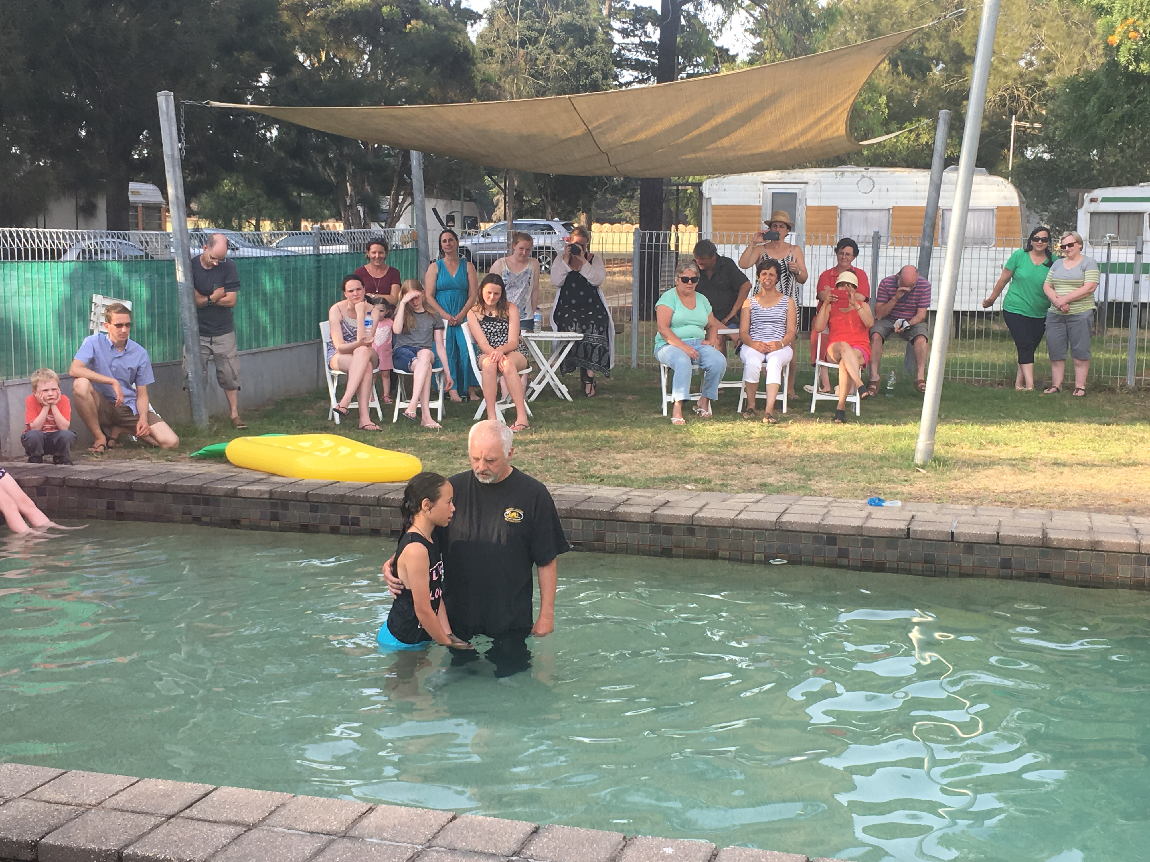 Baptism in the camp pool.